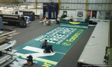 pvc_banner_finishing_pyramidvisuals_factory_floor
